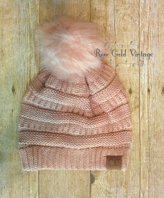 a5572069665 A little twist on the popular CC beanie hats - a faux fur pom pom on