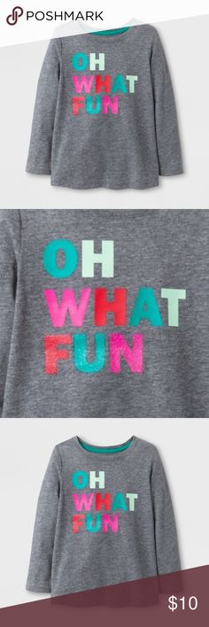 "New CAT & JACK Girls' Oh What Fun Long Sleeve Tee She can show her festive cheer with the Oh What Fun T-Shirt from Cat and Jack. With a gray background, the colorful letters on this long-sleeve T-Shirt pop as they spell out ""Oh What Fun,"" with a touch of glitter decorating ""Fun."" Pair with leggings, jeans or a skirt and she'll be ready to sing along to her favorite Christmas carols.  available in size 18M 