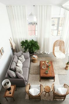 Home-Dzine   In this small living room, the curtains are mounted higher than the actual window size to draw the eye upwards and deflect from the small proportions of the space.