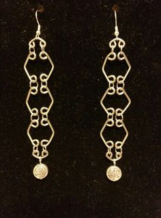 Silver wire links and  metal bead earrings by Dave.