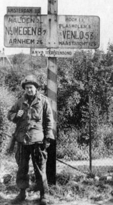 A trooper of 505th Parachute Infantry Regiment, U.S. 82nd Airborne Division, poses for his photograph at Molenhoek, an objective south of Nijmegen on the Maas-Waal Canal (Operation Market-Garden) 1944.