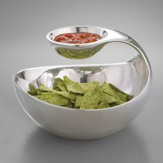 When you serve your guests with this modern, two-tiered piece in metal alloy, you're also serving up a conversation-starter. A smaller vessel hangs over the larger bowl in a graceful arc, allowing for easy, all-in-one-place dipping. Place chips and salsa, vegetables and guacamole, or virtually any other gastronomic pairing in this swan-like server, and wait for the inevitable compliments.
