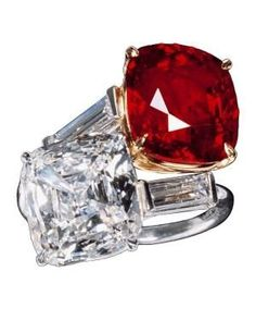 Ruby and Diamond Ring, c.1950, by Cartier. Platinum ring, the shoulders terminating in baguette cut diamonds supporting the bezel set with a square cut diamond and a ruby. by shawna