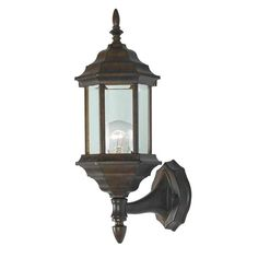This customizable wall lantern features finials, tails and glass that can be configured according to your creative mood. The attractive golden bronze finish of this fixture looks great in any setting.