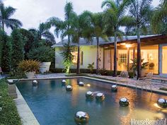 Tropical: Foxtail palms surround the pool in Mario Nievera's Palm Beach house.