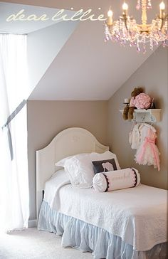 love how simple and minimal yet beautiful this room is...but where are all of her toys? must be a guest room?