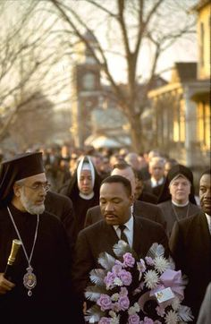 Archbishop Iakovos and Rev. Martin Luther King, Jr. lead the march in Selma, Alabama in 1965.