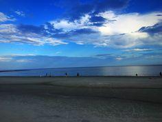 Cloudy blue skies over St. Simons beach
