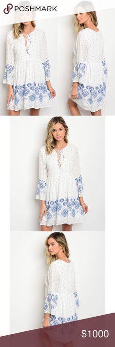 White Dress with V Neck & Bell Sleeve Blue Pattern Arriving Wednesday/Ships Thursday ! White Dress with Bell Sleeve and Blue Pattern. Lace Up V Neck. Fully lined Dress. Fabric is 100% rayon. No Trades. Price is Firm Unless Bundled. GlamVault Dresses