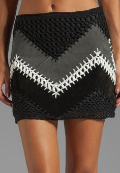 BB DAKOTA Cole Suede/Crochet A-Line Mini Skirt in Black at Revolve Clothing - Good idea.  I could do with less work and more cloth. :)