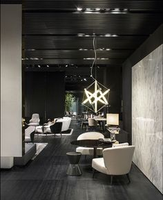 Aston armchair, Cesar coffee table and Bellagio Lounge table, Rodolfo Dordoni Design