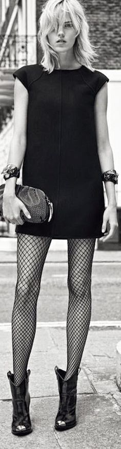 Needs better shoes.  Simple dress ... thick fishnets.  Excellent