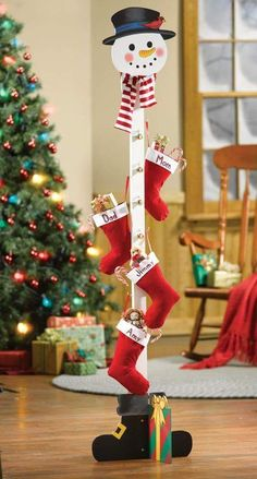 Christmas stocking stand (Or maybe with clothespins all around for Christmas card display) rustic Christmas decorating Christmas Wood Crafts, Farmhouse Christmas Decor, Christmas Snowman, Christmas Projects, Holiday Crafts, Christmas Ornaments, Snowman Crafts, Christmas Lights, Emoji Christmas
