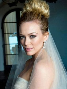 "The Up Top! A gorgeous ""it"" bun for the bride. And you can still wear a veil"
