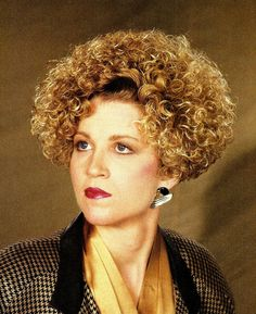 perfect curly perm from the 80s. Wrong that I'd still love to wear this style???