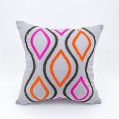 Ikat diamond pillow cover with fabulous embroidery, gorgeous color, and variations on the ever-popular ikat pattern give this decorative pillow instant must-have status. Perfect for accenting neutral decor and pulling a room together.  This pillow cover is available in size 16 x 16, size 18 x 18, size 20 x 20. Please click the drop down menu on the right of the image to see sizes available and pricing.  More geometric pillow covers are available here…