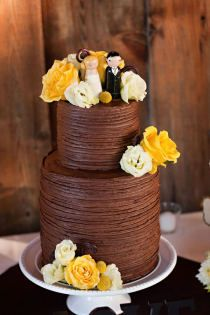 hate the yellow but, hey Jess...look...a chocolate wedding cake!  it would be pretty with blush and ivory flower accents