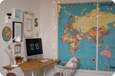 corner office by life made lovely, via Flickr. Love the big map framed with moulding & accented with twinkle lights