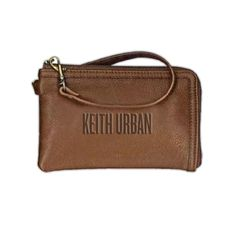 "Keith Urban Wristlet - Keith Urban Web Store $34.99  This genuine brown leather wristlet is perfectly sized to hold your necessities!  The interior features several card slots and a pocket. 6/25"" wide x 4.25"" high with a 12"" strap.  Keith Urban logo debossed in the center.  #wristlet #leatherbag #leather #clutch #spring #fashion #accessory"