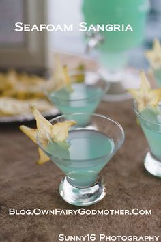 Seafoam Sangria:   3 parts white wine 2 parts blue Hpnotiq Liquer 1 part Ginger Ale Garnish as desired. Large batches are easy to prepare and can be served over ice or chilled.