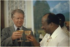 Jimmy Carter and President William Tolbert of Liberia engage in a toast during a state dinner in honor of Jimmy Carter and Rosalynn Carter., 04/03/1978. http://media.nara.gov/media/images/24/8/24-0749a.gif