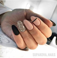 Nude and black nails with accent shimmer nail in almond shape
