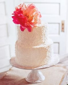 Peony Cake Topper  For a wedding in Monroe, Georgia, an over-sized coral peony topped this couple's white-cake and coconut-cream confection.