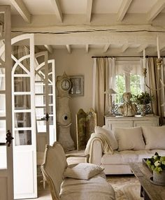 Wonderful mix of textures with painted beams and pale tones.