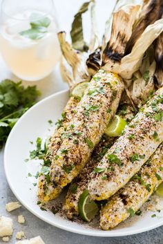 Authentic Mexican Street Corn on the cob covered in mayo and topped with cilantro, Cotija cheese and chili powder is the perfect Mexican summer side dish!