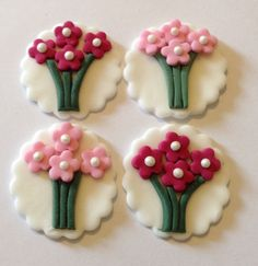 12 x edible icing flower bunch cupcake toppers cake decorations. Available on EBay £16.00.