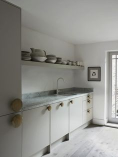 Faye Toogood Kitchen with Muuto Dot hangers as knobs for the Ikea cabinets. Photo Henry Bourne /Remodelista