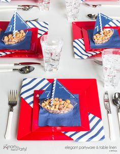 A cute, vivid, and patriotic tablescape for the 4th of July.  We made the boats (which act as a place card) out of our mini dishes, straws, and construction paper.  |  SmartyHadAParty.com