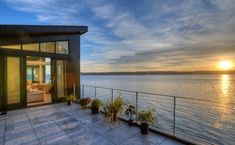 Read The Saratoga Hill House designed by Design Northwest Architects on Camano Island in Washington State is a house that has been created in close connection with Modern Wooden House, Camano Island, Beachfront House, Seattle Homes, Concrete Stairs, House On Stilts, Beach Properties, House On A Hill, Waterfront Homes