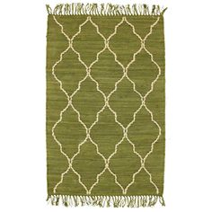 This cotton rug is accented with a tan hand-loomed jute trellis.