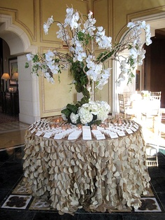 Escort card table with orchids, Shelly has a purple tablecloth just like this that we thought of for the guest book table, wow pretty
