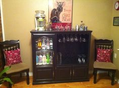 Okay, new plan, Craigslist, you can't have my old entertainment center anymore...making it into a bar/china cabinet! (Kinda like this picture but with my dishes and nice silverware instead of liquor...I'll keep that where it is)
