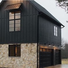 modern home accents Black Moder Farmhouse with black board and batten siding, Flagstone stone accent and black garage doors - - Design Exterior, Exterior House Colors, Exterior Doors, Exterior Paint, Diy Exterior, Modern Exterior, Black House Exterior, Garage Exterior, Bungalow Exterior