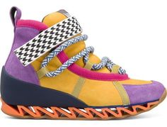 For Spring Summer 2013 Camper presents Himalaya, a yellow, purple and pink basket mid ankle boot with a 3cm  interior wedge heel made of suede.
