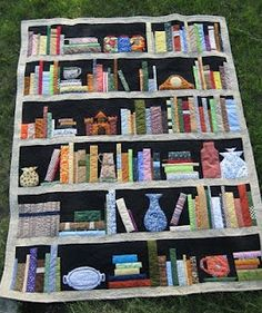"I'm working on a library shelf quilt, similar to this one, through a ""swap"" of blocks with other quilters I've met online, so we'lll all have some surprise books.  The ones I'm making have titles (of published books) that mention specific colors, with the exception of very few."