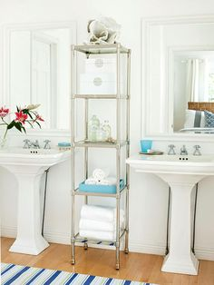 Twin pedestal sinks enhance convenience in the guest bath, allowing both members of a couple to get ready at the same time. To provide storage space for bath supplies and counterspace for toiletries, include a freestanding or built-in hutch like this one. Set out a tray to hold your guests' makeup bottles, and provide a cup or holder for toothbrushes and toothpaste. These thoughtful touches help visitors feel at home and keep the space uncluttered./