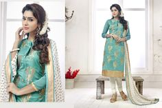 This beautiful straight cut suit has copper colored floral embroidery work on all over the top with beads pattern on the neck line. The copper colored zari on the border. The sea blue colored top is fabricated in chanderi silk, while the bottom is made of cotton fabric. The najneen fabric dupatta. Buy this lovely suit now.