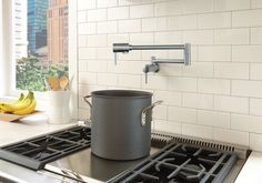Boost cooking convenience in your kitchen with a pot filler above the range.
