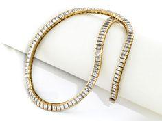 """Halsweite: ca. 41,5 cm. Gewicht: ca. 43,5 g. GG 750. Signiert """"Adler"""". Hochwertiges elegantes Collier im leichten Verlauf besetzt mit hochfeinen Diamanten..."""