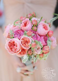 Get romantic with garden roses! Garden roses in various stages of bloom add depth to this breathtaking bouquet, perfectly pretty for a summer garden wedding.