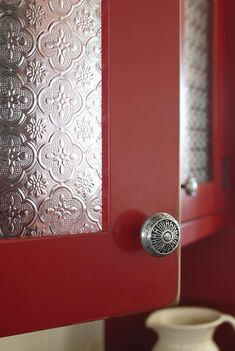 Kitchen cabinet detail using decorative metal sheeting. Design by Susan Burns