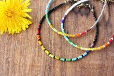 https://www.etsy.com/nl/listing/230386628/seed-parel-armband-rainbow-kies-een-1
