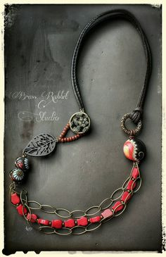 Mixed media necklace with golem studio ceramics, wood leaf connector, leather cord, brass chain, and red coral beads, by Brass Rabbit Studio on Etsy https://www.etsy.com/listing/220168330/bohemian-long-necklace-mixed-media-multi