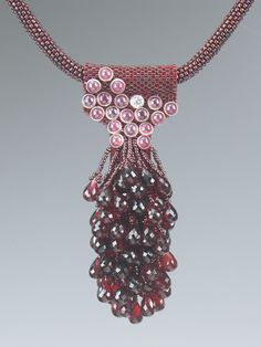 Pink Buttons necklace by Kay Bonitz. Garnets, pink glass vintage buttons plus seed beads and Delicas make up this lovely necklace.