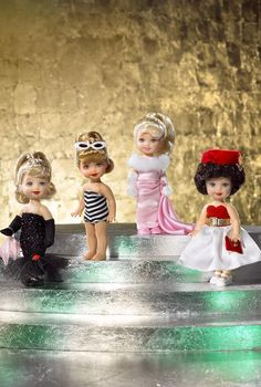 Kelly dolls dressed as classic Barbies