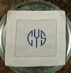 Monogrammed Cocktail Napkins in the Natural Circle Font (set of 4). $14.00, via Etsy.